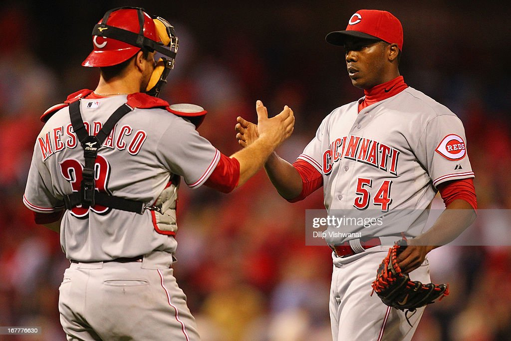 Reliever <a gi-track='captionPersonalityLinkClicked' href=/galleries/search?phrase=Aroldis+Chapman&family=editorial&specificpeople=5753195 ng-click='$event.stopPropagation()'>Aroldis Chapman</a> #54 and <a gi-track='captionPersonalityLinkClicked' href=/galleries/search?phrase=Devin+Mesoraco&family=editorial&specificpeople=5745587 ng-click='$event.stopPropagation()'>Devin Mesoraco</a> #39 both of the Cincinnati Reds congratulate each other after beating the St. Louis Cardinals at Busch Stadium on April 29, 2013 in St. Louis, Missouri. The Reds beat the Cardinals 2-1.