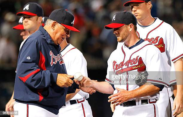 Reliever Billy Wagner of the Atlanta Braves hands the game ball over to manager Bobby Cox after their 32 win over the Chicago Cubs at Turner Field on...
