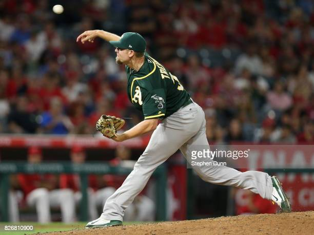 Reliever Blake Treinen of the Oakland Athletics throws pitch in the nint inning against the Los Angeles Angels of Anaheim at Angel Stadium of Anaheim...
