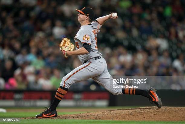 Reliever Brad Brach of the Baltimore Orioles delivers a pitch during a game against the Baltimore Orioles at Safeco Field on August 15 2017 in...