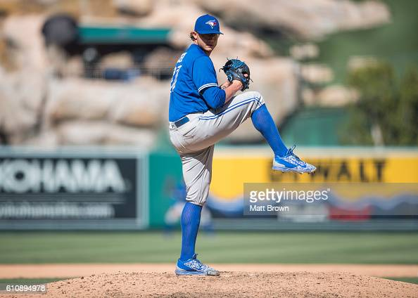 Reliever Brett Cecil of the Toronto Blue Jays pitches during the seventh inning of the game against the Los Angeles Angels of Anaheim at Angel...