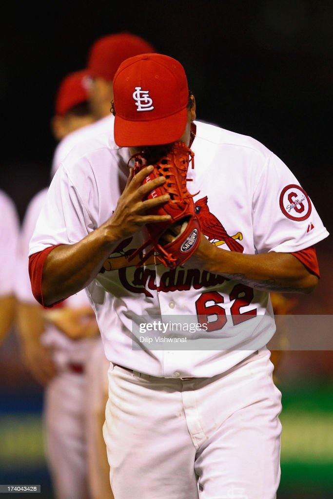 Reliever Carlos Martinez #62 of the St. Louis Cardinals is pulled form the game after allowing three runs in the ninth inning against the San Diego Padres at Busch Stadium on July 19, 2013 in St. Louis, Missouri. The Cardinals beat the Padres 9-6.