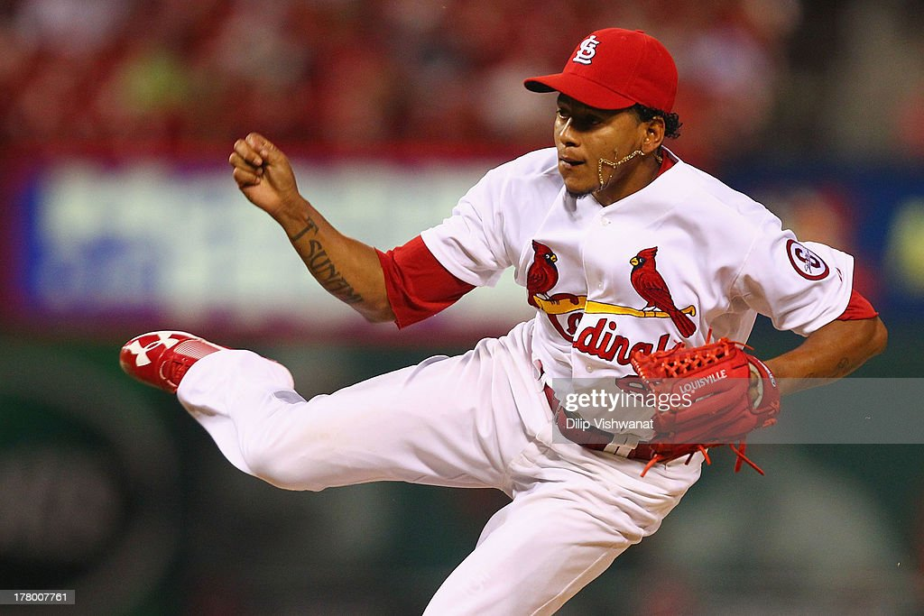 Reliever Carlos Martinez #62 of the St. Louis Cardinals pitches against the Cincinnati Reds at Busch Stadium on August 26, 2013 in St. Louis, Missouri. The Cardinals beat the Reds 8-6.