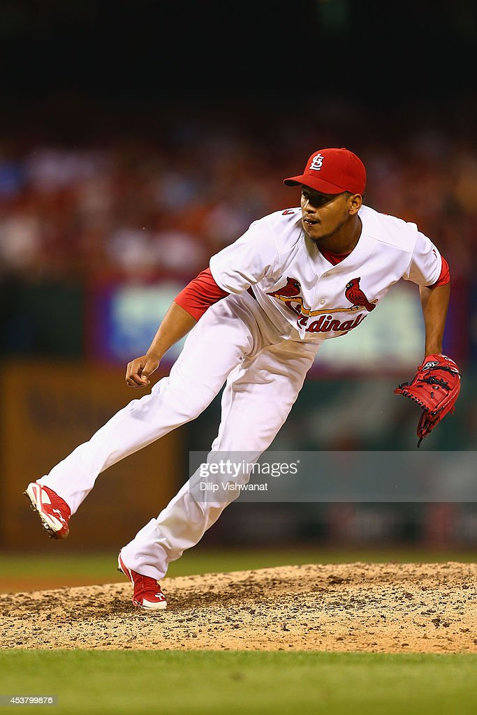 Reliever Carlos Martinez #44 of the St. Louis Cardinals pitches against the Cincinnati Reds in the sixth inning at Busch Stadium on August 18, 2014 in St. Louis, Missouri. The Cardinals beat the Reds in 10 innings.