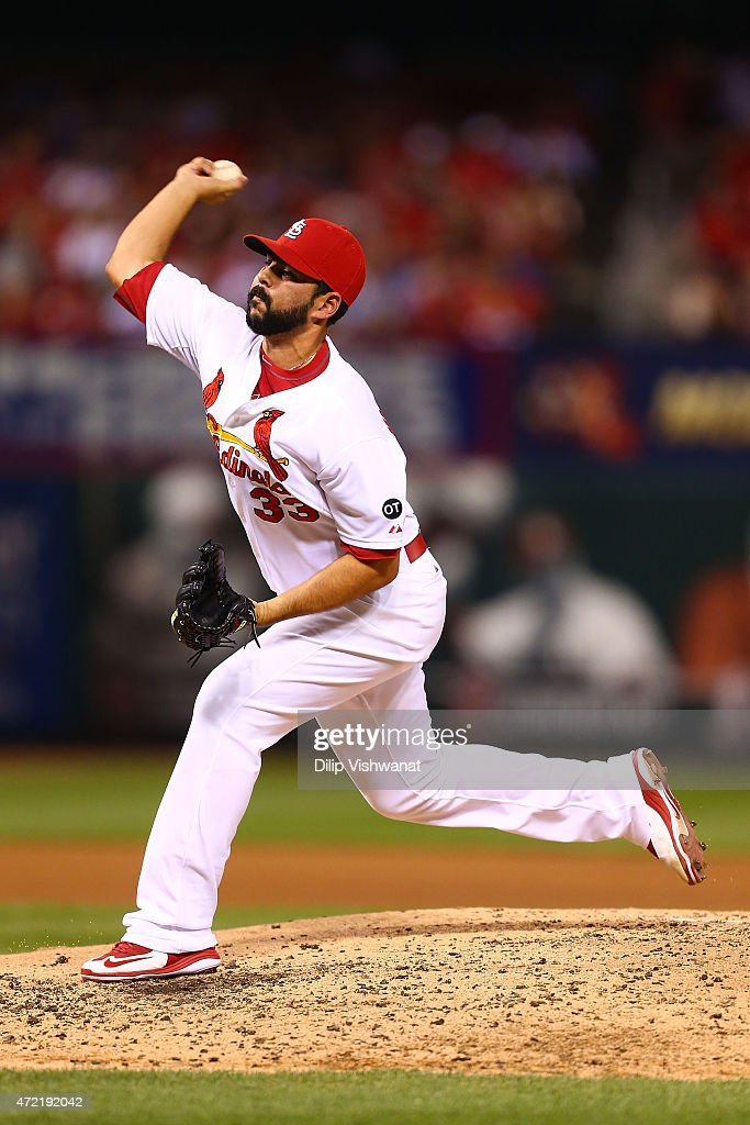 Reliever <a gi-track='captionPersonalityLinkClicked' href=/galleries/search?phrase=Carlos+Villanueva+-+Joueur+de+baseball&family=editorial&specificpeople=10553069 ng-click='$event.stopPropagation()'>Carlos Villanueva</a> #33 of the St. Louis Cardinals pitches against the Chicago Cubs in the fourth inning at Busch Stadium on May 4, 2015 in St. Louis, Missouri.