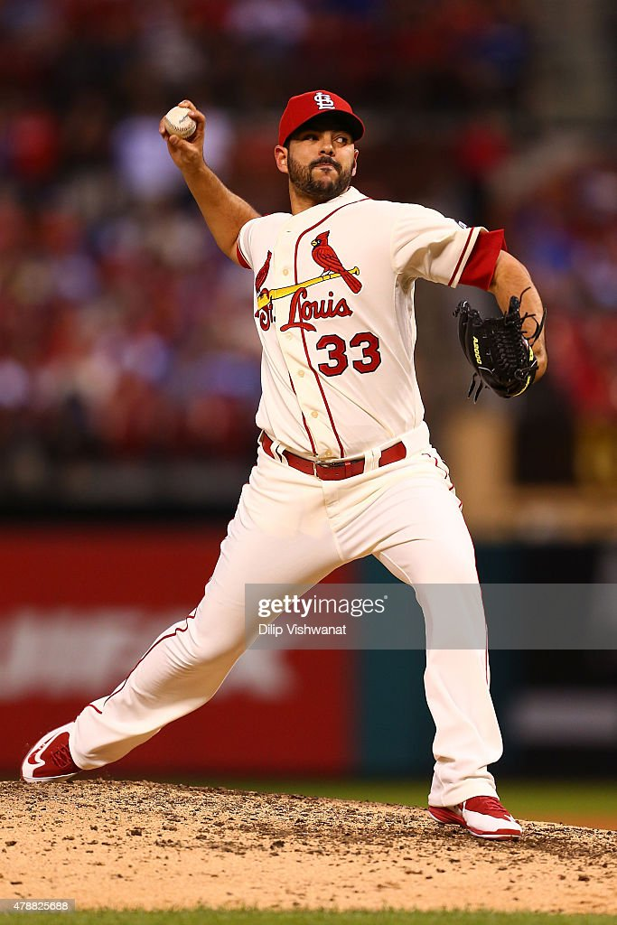 Reliever <a gi-track='captionPersonalityLinkClicked' href=/galleries/search?phrase=Carlos+Villanueva+-+Joueur+de+baseball&family=editorial&specificpeople=10553069 ng-click='$event.stopPropagation()'>Carlos Villanueva</a> #33 of the St. Louis Cardinals pitches against the Chicago Cubs in the seventh inning at Busch Stadium on June 27, 2015 in St. Louis, Missouri.