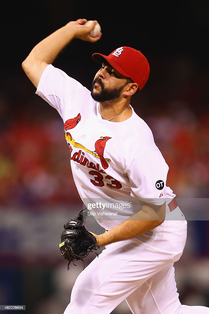 Reliever <a gi-track='captionPersonalityLinkClicked' href=/galleries/search?phrase=Carlos+Villanueva+-+Baseballspieler&family=editorial&specificpeople=10553069 ng-click='$event.stopPropagation()'>Carlos Villanueva</a> #33 of the St. Louis Cardinals pitches against the Cincinnati Reds in the seventh inning at Busch Stadium on July 28, 2015 in St. Louis, Missouri.