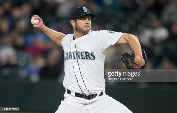 Reliever Casey Fien of the Seattle Mariners delivers a pitch during a game against the Houston Astros at Safeco Field on April 11 2017 in Seattle...