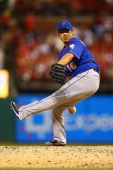 Reliever Daisuke Matsuzaka of the New York Mets pitches against the St Louis Cardinals in the seventh inning at Busch Stadium on June 17 2014 in St...