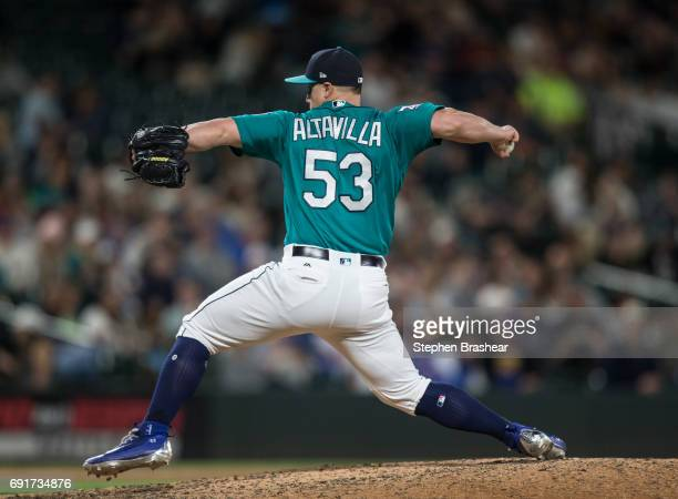 Reliever Dan Altavilla of the Seattle Mariners delivers a pitch during the eighth inning of a game against the Tampa Bay Rays at Safeco Field on June...