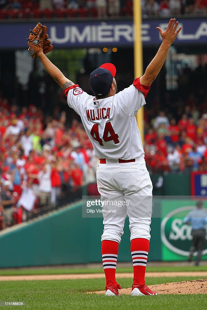 Reliever Edward Mujica of the St Louis Cardinals celebrates after recording the final pout of the game against the San Diego Padres at Busch Stadium...