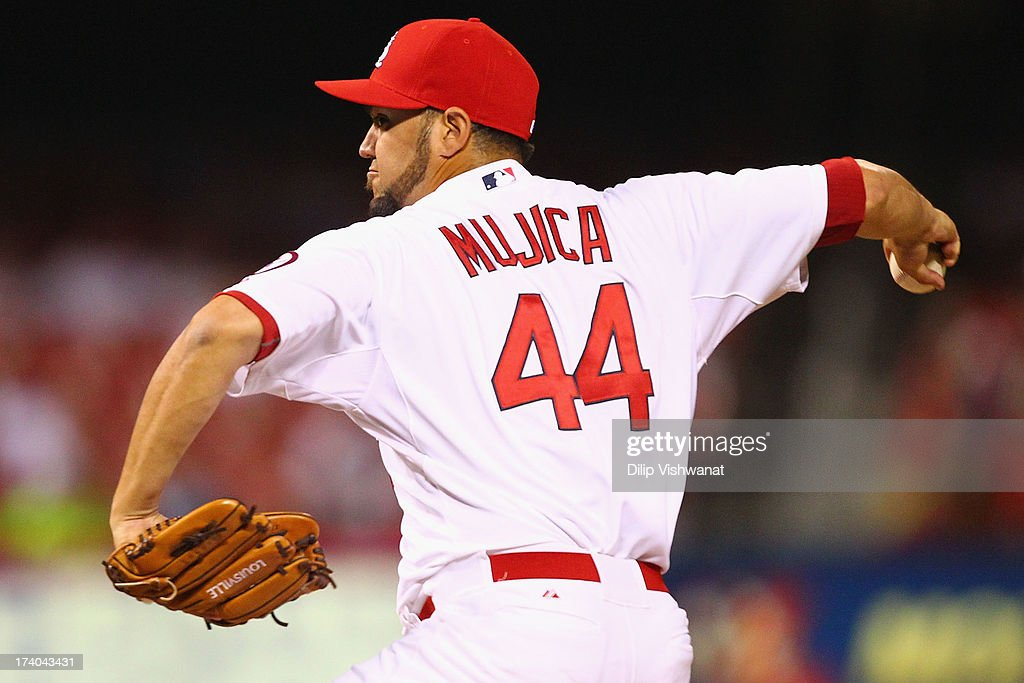Reliever <a gi-track='captionPersonalityLinkClicked' href=/galleries/search?phrase=Edward+Mujica&family=editorial&specificpeople=836179 ng-click='$event.stopPropagation()'>Edward Mujica</a> #44 of the St. Louis Cardinals pitches against the San Diego Padres at Busch Stadium on July 19, 2013 in St. Louis, Missouri. The Cardinals beat the Padres 9-6.