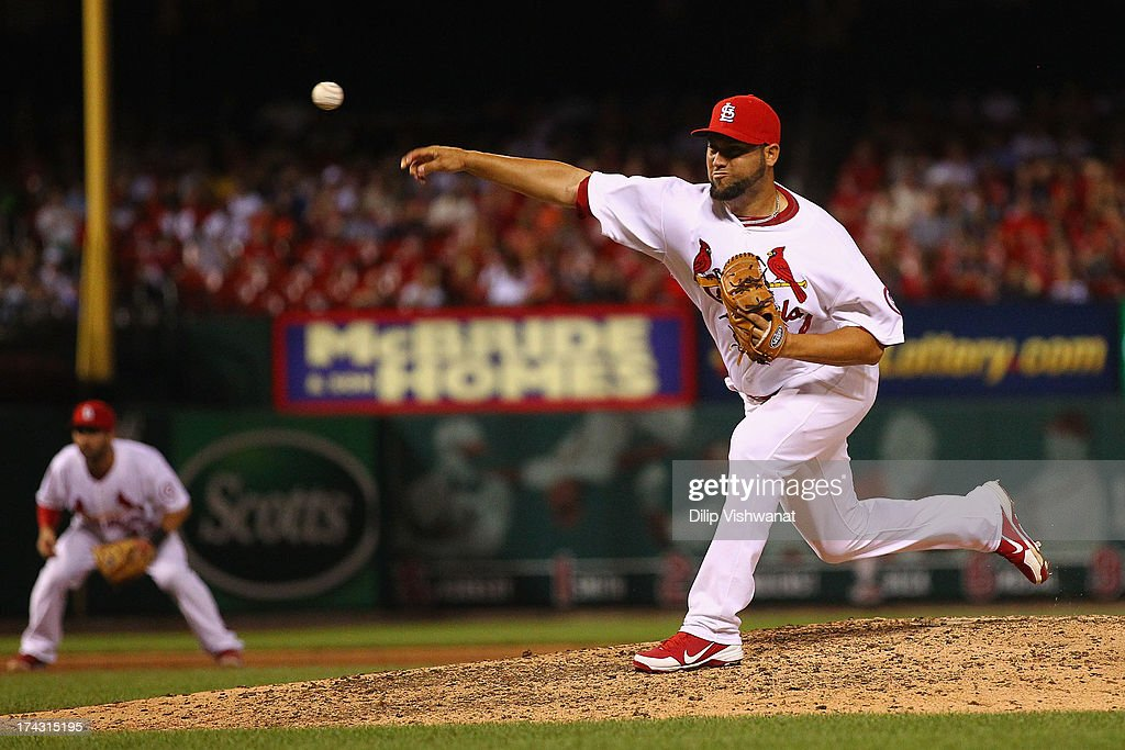 Reliever <a gi-track='captionPersonalityLinkClicked' href=/galleries/search?phrase=Edward+Mujica&family=editorial&specificpeople=836179 ng-click='$event.stopPropagation()'>Edward Mujica</a> #44 of the St. Louis Cardinals pitches against the Philadelphia Phillies at Busch Stadium on July 23, 2013 in St. Louis, Missouri. The Cardinals beat the Phillies 4-1.