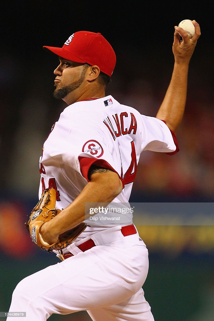 Reliever <a gi-track='captionPersonalityLinkClicked' href=/galleries/search?phrase=Edward+Mujica&family=editorial&specificpeople=836179 ng-click='$event.stopPropagation()'>Edward Mujica</a> #44 of the St. Louis Cardinals pitches against the Philadelphia Phillies at Busch Stadium on July 25, 2013 in St. Louis, Missouri. The Cardinals beat the Phillies 3-1.