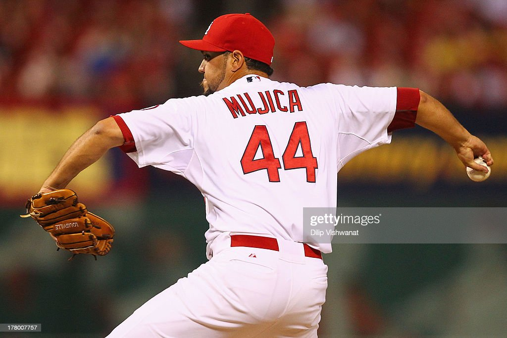 Reliever <a gi-track='captionPersonalityLinkClicked' href=/galleries/search?phrase=Edward+Mujica&family=editorial&specificpeople=836179 ng-click='$event.stopPropagation()'>Edward Mujica</a> #44 of the St. Louis Cardinals pitches against the Cincinnati Reds at Busch Stadium on August 26, 2013 in St. Louis, Missouri. The Cardinals beat the Reds 8-6.