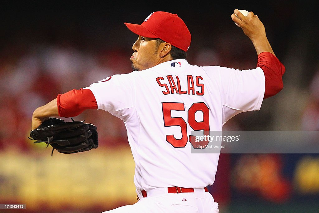 Reliever <a gi-track='captionPersonalityLinkClicked' href=/galleries/search?phrase=Fernando+Salas&family=editorial&specificpeople=3016070 ng-click='$event.stopPropagation()'>Fernando Salas</a> #59 of the St. Louis Cardinals pitches against the San Diego Padres at Busch Stadium on July 19, 2013 in St. Louis, Missouri. The Cardinals beat the Padres 9-6.