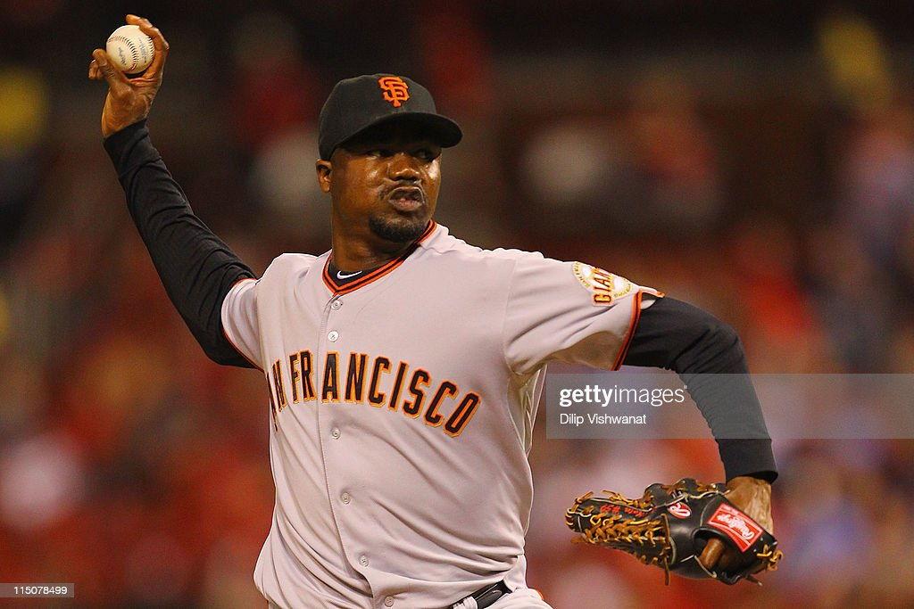 Reliever <a gi-track='captionPersonalityLinkClicked' href=/galleries/search?phrase=Guillermo+Mota&family=editorial&specificpeople=208080 ng-click='$event.stopPropagation()'>Guillermo Mota</a> #59 of the San Francisco Giants pitches against the St. Louis Cardinals at Busch Stadium on June 2, 2011 in St. Louis, Missouri.