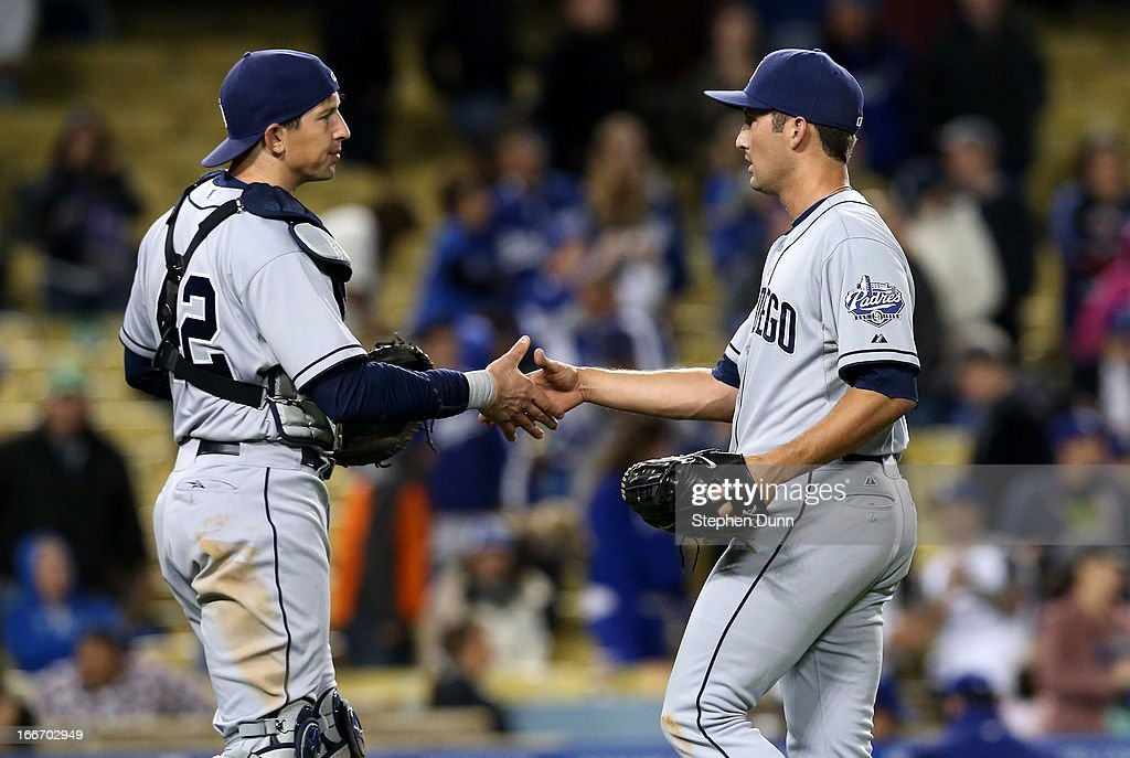 Reliever <a gi-track='captionPersonalityLinkClicked' href=/galleries/search?phrase=Huston+Street&family=editorial&specificpeople=212959 ng-click='$event.stopPropagation()'>Huston Street</a> and catcher John Baker of the San Diego Padres shake hands after getting the final out against the Los Angeles Dodgers at Dodger Stadium on April 15, 2013 in Los Angeles, California. All uniformed team members are wearing jersey number 42 in honor of Jackie Robinson Day. The Padres won 6-3.