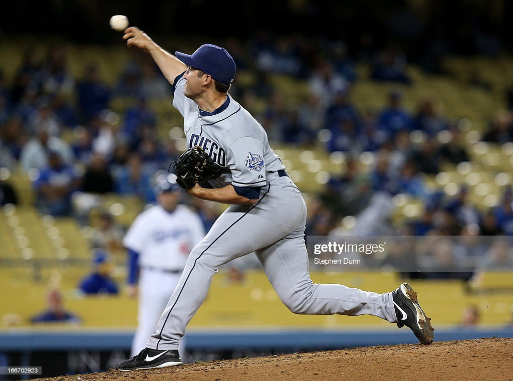 Reliever <a gi-track='captionPersonalityLinkClicked' href=/galleries/search?phrase=Huston+Street&family=editorial&specificpeople=212959 ng-click='$event.stopPropagation()'>Huston Street</a> of the San Diego Padres throws a pitch in the ninth inning on his way to picking up the save against the Los Angeles Dodgers at Dodger Stadium on April 15, 2013 in Los Angeles, California. All uniformed team members are wearing jersey number 42 in honor of Jackie Robinson Day. The Padres won 6-3.