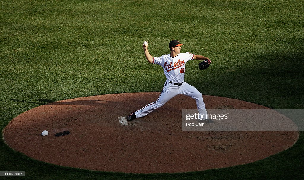 Reliever Jason Berken #49 of the Baltimore Orioles delivers to a Detroit Tigers batter during the seventh inning during opening day at Oriole Park at Camden Yards on April 4, 2011 in Baltimore, Maryland.
