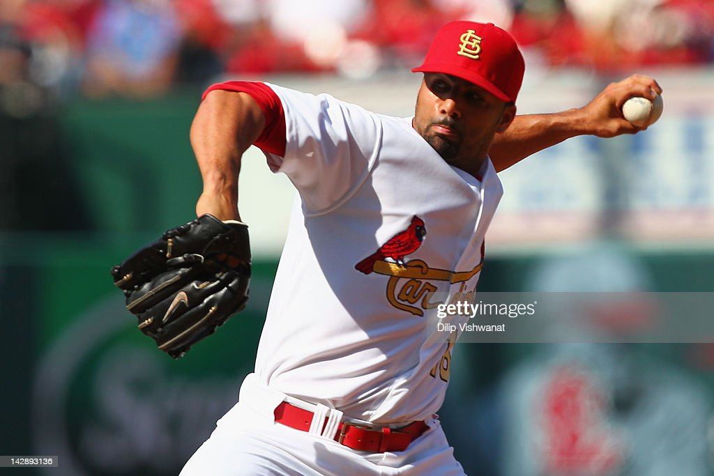 Reliever <a gi-track='captionPersonalityLinkClicked' href=/galleries/search?phrase=J.C.+Romero&family=editorial&specificpeople=225049 ng-click='$event.stopPropagation()'>J.C. Romero</a> #16 of the St. Louis Cardinals pitches against the Chicago Cubs at Busch Stadium on April 14, 2012 in St. Louis, Missouri.