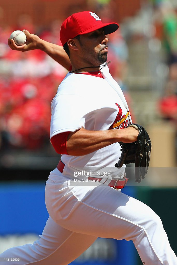 Reliever JC Romero of the St Louis Cardinals pitches against the Cincinnati Reds at Busch Stadium on April 19 2012 in St Louis Missouri The Reds...