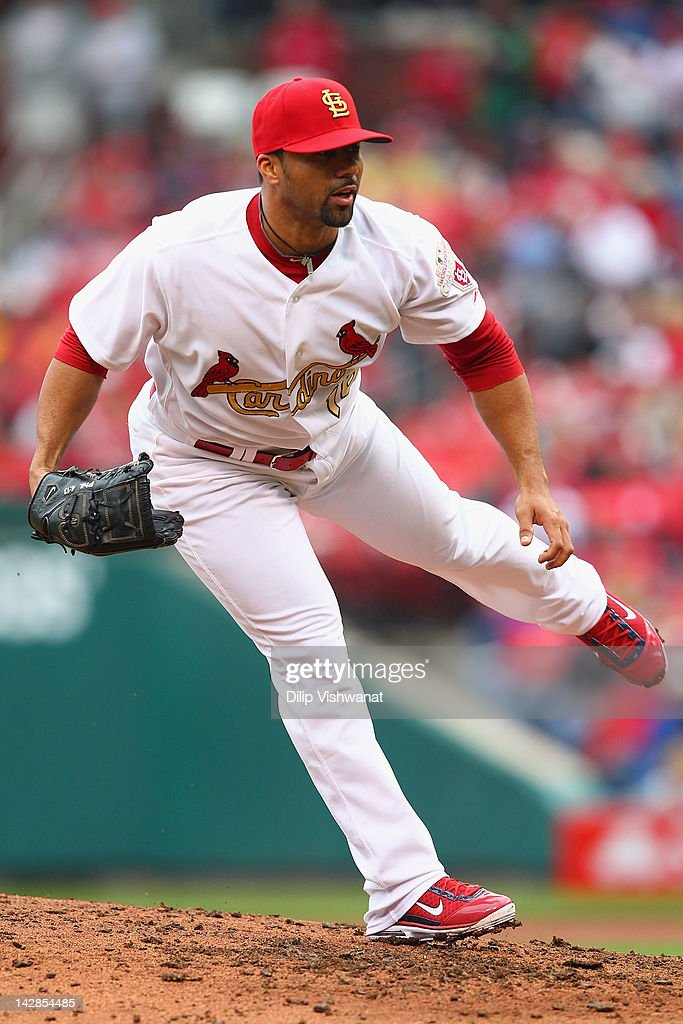 Reliever <a gi-track='captionPersonalityLinkClicked' href=/galleries/search?phrase=J.C.+Romero&family=editorial&specificpeople=225049 ng-click='$event.stopPropagation()'>J.C. Romero</a> #16 of the St. Louis Cardinals pitches against the Chicago Cubs during the home-opening game at Busch Stadium on April 13, 2012 in St. Louis, Missouri. The Cubs beat the Cardinals 9-5.