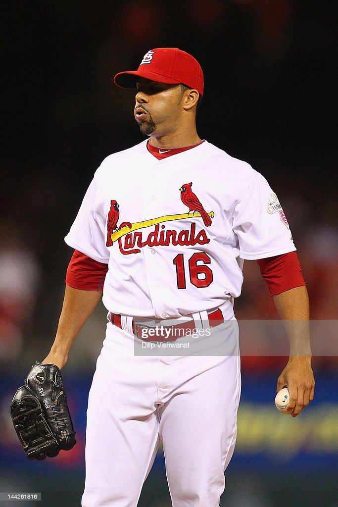Reliever JC Romero of the St Louis Cardinals reacts to giving up a home run against the Atlanta Braves at Busch Stadium on May 12 2012 in St Louis...