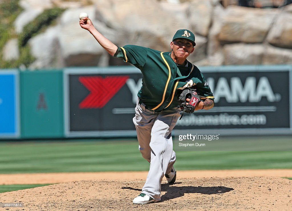 Reliever <a gi-track='captionPersonalityLinkClicked' href=/galleries/search?phrase=Jesse+Chavez&family=editorial&specificpeople=4175363 ng-click='$event.stopPropagation()'>Jesse Chavez</a> #60 of the Oakland Athletics throws a pitch against the Los Angeles Angels of Anaheim at Angel Stadium of Anaheim on August 31, 2014 in Anaheim, California.