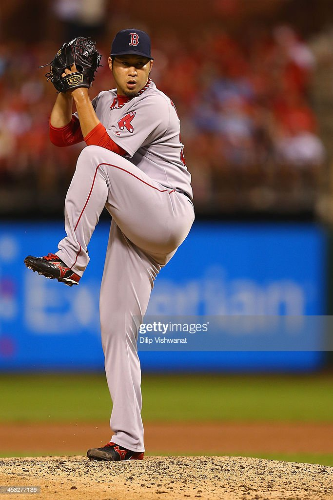 Reliever <a gi-track='captionPersonalityLinkClicked' href=/galleries/search?phrase=Junichi+Tazawa&family=editorial&specificpeople=4624306 ng-click='$event.stopPropagation()'>Junichi Tazawa</a> #36 of the Boston Red Sox pitches against the St. Louis Cardinals in the eighth inning at Busch Stadium on August 6, 2014 in St. Louis, Missouri. The Red Sox beat the Cardinals 2-1.