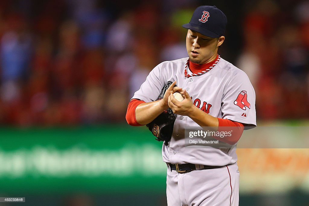 Reliever <a gi-track='captionPersonalityLinkClicked' href=/galleries/search?phrase=Junichi+Tazawa&family=editorial&specificpeople=4624306 ng-click='$event.stopPropagation()'>Junichi Tazawa</a> #36 of the Boston Red Sox reacts after giving up what would become the game-winning run against the St. Louis Cardinals in the eighth inning at Busch Stadium on August 5, 2014 in St. Louis, Missouri. The Cardinals beat the Red Sox 3-2.