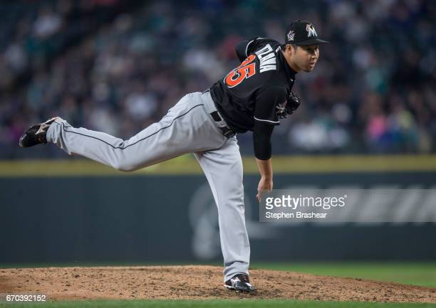 Reliever Junichi Tazawa of the Miami Marlins delivers a pitch during the sixth inning of a game a game against the Seattle Mariners at Safeco Field...