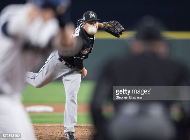 Reliever Junichi Tazawa of the Miami Marlins delivers a pitch during the seventh inning of a game against the Seattle Mariners at Safeco Field on...