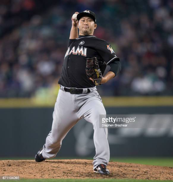 Reliever Junichi Tazawa of the Miami Marlins delivers a pitch during the sixth inning of a game at Safeco Field on April 19 2017 in Seattle...