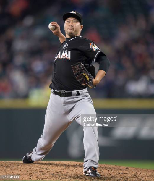 Reliever Junichi Tazawa of the Miami Marlins delivers a pitch during a game at Safeco Field on April 19 2017 in Seattle Washington The Mariners won...