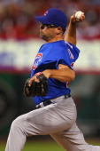 Reliever Kevin Gregg of the Chicago Cubs pitches against the St Louis Cardinals at Busch Stadium on August 9 2013 in St Louis Missouri The Cubs beat...