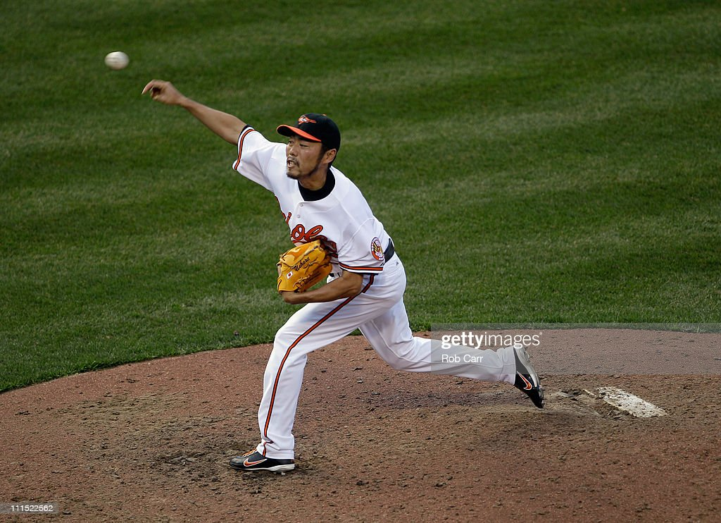 Reliever <a gi-track='captionPersonalityLinkClicked' href=/galleries/search?phrase=Koji+Uehara&family=editorial&specificpeople=801278 ng-click='$event.stopPropagation()'>Koji Uehara</a> #19 of the Baltimore Orioles delivers to a Detroit Tigers batter during the ninth inning during opening day at Oriole Park at Camden Yards on April 4, 2011 in Baltimore, Maryland.