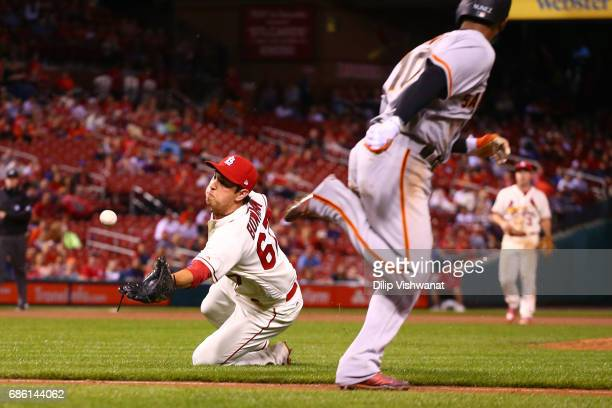 Reliever Matt Bowman of the St Louis Cardinals catches a popup against the San Francisco Giants in the eleventh inning at Busch Stadium on May 20...