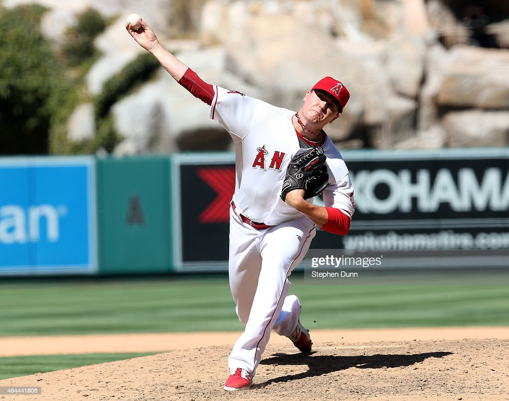 Reliever Mike Morin #64 of the Los Angeles Angels of Anaheim throws a pitch against the Oakland Athletics at Angel Stadium of Anaheim on August 31, 2014 in Anaheim, California. The Angels won 8-1 to complete a four game sweep.