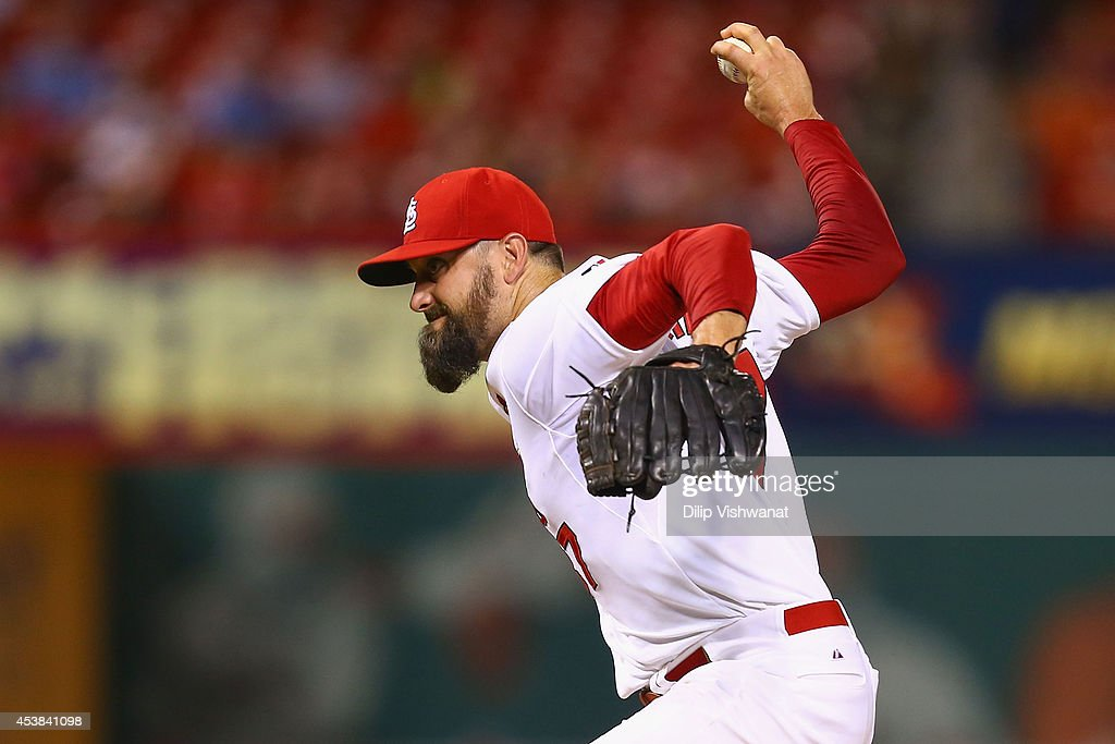 Reliever <a gi-track='captionPersonalityLinkClicked' href=/galleries/search?phrase=Pat+Neshek&family=editorial&specificpeople=743495 ng-click='$event.stopPropagation()'>Pat Neshek</a> #37 of the St. Louis Cardinals pitches against the Cincinnati Reds in the ninth inning at Busch Stadium on August 19, 2014 in St. Louis, Missouri. The Cardinals beat the Reds 5-4.