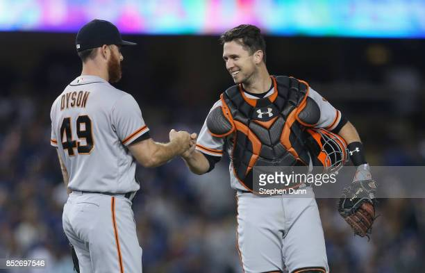 Reliever Sam Dyson and catcher Buster Posey of the San Francisco Giants celebrate after Dyson pitched the ninth inning to pick up the save against...