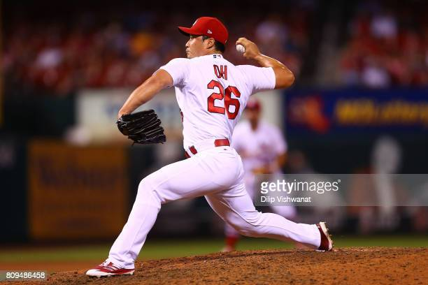 Reliever SeungHwan Oh of the St Louis Cardinals delivers a pitch against the Miami Marlins in the ninth inning at Busch Stadium on July 5 2017 in St...