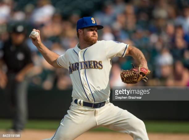 Reliever Shae Simmons of the Seattle Mariners delivers a pitch during the ninth inning of a game against the Oakland Athletics at Safeco Field on...