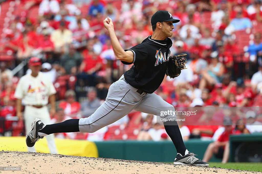 Reliever <a gi-track='captionPersonalityLinkClicked' href=/galleries/search?phrase=Steve+Cishek&family=editorial&specificpeople=7542919 ng-click='$event.stopPropagation()'>Steve Cishek</a> #31 of the Miami Marlins pitches against the St. Louis Cardinals in the ninth inning at Busch Stadium on July 5, 2014 in St. Louis, Missouri. The Marlins beat the Cardinal 6-5.