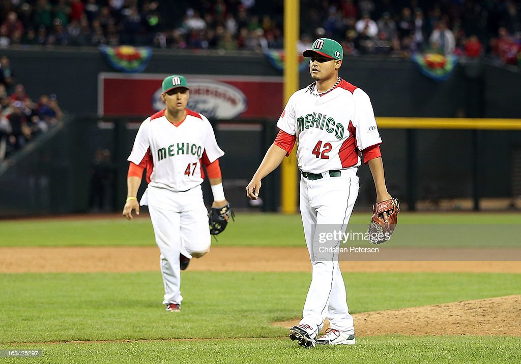 Relif pitcher Arnold Leon #42 of Mexico walks toward home plate after hitting Rene Tosoni (not pictured) of Canada with a pitch during the ninth inning of the World Baseball Classic First Round Group D game at Chase Field on March 9, 2013 in Phoenix, Arizona. Canada defeated Mexico 10-3.