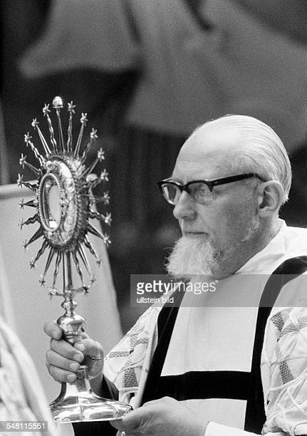 religion Christianity Corpus Christi priest carries the solar monstrance aged 50 to 70 years Basilius