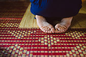 prayers in the temple, meditation. a thematic photo, a person prays in a Buddhist temple or in a mosque