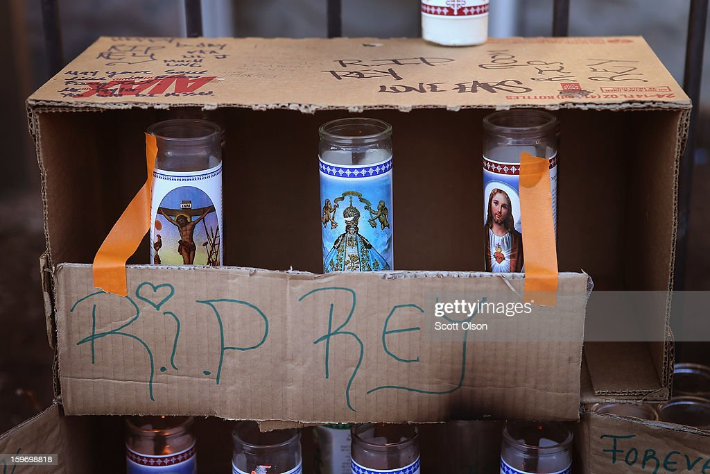 Religious candles form part of a memorial in front of the home of Rey Dorantes on January 17, 2013 in Chicago, Illinois. Fourteen-year-old Dorantes died after being shot 6 times while he was sitting on the front porch of his home on January 11. Dorantes' murder was the 21st homicide recorded in Chicago for 2013, a city which saw more than 500 homicides in 2012.