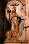 Religious carving on wooden door
