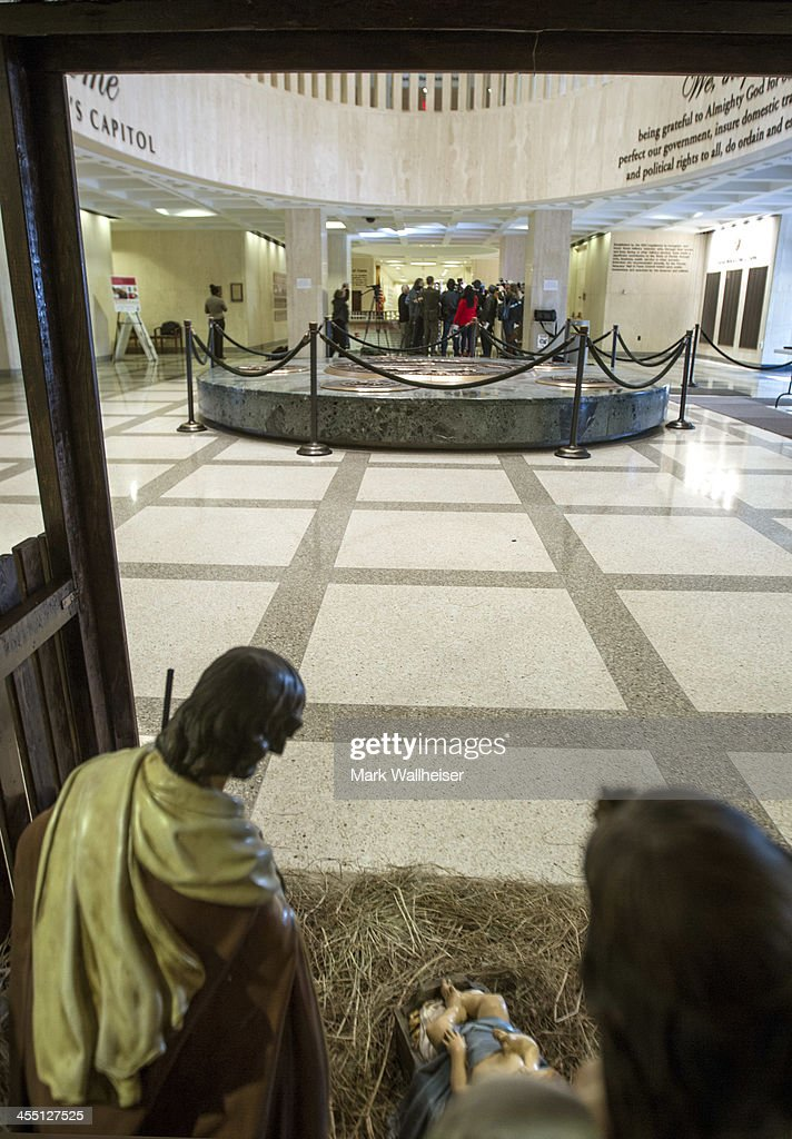 A religious Christian Nativity manger sits in the foreground as the media assembles around Chaz Stevens from Deerfield Beach Florida and his Festivus...
